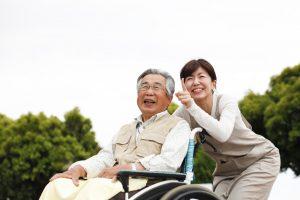woman-assisting-elderly-man-in-wheelchair