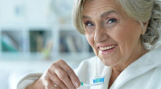 senior-woman-brushing-her-teeth
