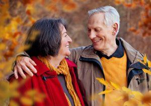 seniors-walking-in-autumn-forest