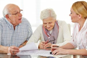 Couple of senior citizens talking to lawyer about their will