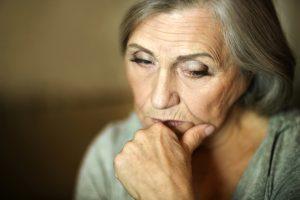 Portrait of a thoughtful sad elderly woman